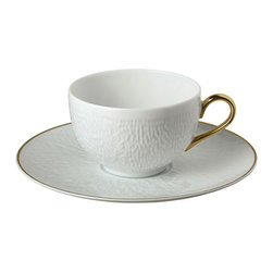 Raynaud - Mineral Gold Porcelain Tea Cup and Saucer - The Mineral Gold dinnerware, which is a refined creation of Thierry Cheyrou, plays with different surface textures. Grainy structures are combined with smooth, shiny areas to create a harmonious whole. Casual or formal, this collection offers great practicality and adapts to every occasion.