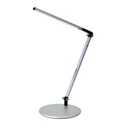 "Koncept - Koncept Gen 3 Z-Bar Solo Warm Light LED Silver Desk Lamp - The silver Gen 3 Z-Bar Solo LED desk light is a compact design with a single arm and an LED head that can fold flat against the body. It produces 40% more light than Gen 2 models and features improved design and adjustability. The detachable head can spin sweep side to side and rotate in any direction held securely in place by a weighted base. A convenient control strip allows one touch on/off and LED dimmer operations. The energy efficient LEDs produce a cool ""daylight"" that will last for up to 50000 hours. Five year manufacturer's warranty. This energy saving light earns LEED credits. Aluminum construction. Silver finish. One touch dimming and on/off. 9' black power cord. Includes twenty-eight 7 watt LEDs. 3200-3700K color temperature warm light; CRI 85. LED lifespan up to 50000 hours. Adjustable positions; maximum extension is 37 1/4"" high. Round base is 7 1/2"" wide.  Aluminum construction.   Silver finish.   One touch dimming and on/off.   Includes 35 LEDs with 8.5 watts total energy consumption.  3200-3700K color temperature warm light; CRI 85.   LED lifespan up to 50000 hours.   Earns LEED credits.  18"" column height plus 19"" adjustable arm.  7 1/2"" diameter weighted base.  9' black power cord.   5 year manufacturer's limited warranty."