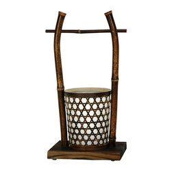 """Oriental Unlimted - Japanese Rice Bucket Bamboo Woven Lantern - The bucket shaped shade is decorated with stripped bamboo woven in a classic """"caning"""" design. A simple, unique decorative lantern. An interesting and thoughtful gift idea. From a collection of unique Japanese design craft lanterns. The beautiful, rustic finish of the small gauge bamboo pole gives this table top lamp an authentic look and feel. Rice is central to life in East Asia, and the gift of a rice bucket is considered auspicious, bringing good luck to the household. Hand crafted from steam bent bamboo pole mounted on a stained wooden base. No assembly required. 6.25 in. L x 9 in. W x 15.75 in. H"""