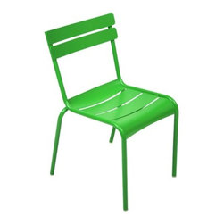 "Fermob - Luxembourg Stacking Chair Set of 4 by Fermob - The Fermob Luxembourg Stacking Chair Set of 4 complements the Luxembourg Tables with the same smooth style (inspired by the furniture in the Jardin du Luxembourg in Paris) and vast array of durable powder coat colors. These side chairs are made entirely out of sturdy yet lightweight aluminum, and are stackable for easy storage. Based in Thoissey, France, Fermob has been creating fine outdoor furniture since 1953. Their current line of colorful and comfortable aluminum and steel furniture promotes the ""Outdoor Lounge"" way of life. It encourages outdoor rest and relaxation while caring for, protecting and improving the environment it inhabits. All Fermob outdoor furniture is made in France out of recyclable materials."
