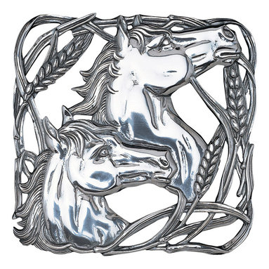 Arthur Court - Horse/Wheat Trivet - Two proudly lifted horse heads framed with wheat accents give this table trivet a majestic, earthy beauty. The design uses flowing lines to capture the graceful motion and vitality of horses. Handcrafted from brilliant sand cast aluminum, this trivet will neither tarnish nor require polishing.