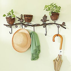 Bird Nest Coat Rack - This would put a smile on my face every day if it were hanging in my house. The sweet birds and nests add a wonderful element of whimsy, and the fact that you can decorate the nests seasonally is definitely a bonus.