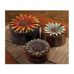 IMAX Worldwide Home - Felicity 3-Pc Storage Box Set - Includes small, medium and large box. Dimensional flower. Round shaped. Made from 95% wrought iron and 5% acrylic. Small: 3.5 in. W x 8 in. H. Medium: 6 in. W x 9 in. H. Large: 7.5 in. W x 11 in. H. Weight: 7.7 lbs.Each display gems that shine for your treasures inside!