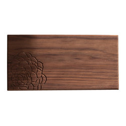 DMWR - Echeveria Cutting Board - Handmade from beautiful, solid walnut and carved with an echeveria in the corner, this cutting board actually qualifies as kitchen art — it's got a wall-hanging keyhole on the back to prove it. Now the food you're preparing won't be the only thing on your kitchen counter that's succulent.