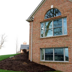 Treesdale Townhouse Project - Exterior of Living Room and Family Room - Photographs by: Metropolitan Window Company 800-655-8411