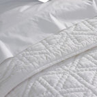 Coyuchi - Coyuchi Swiss Dot Organic Cotton Quilt - Our fluffy cotton quilt pairs the delicate texture of Swiss dot with sheer, smooth voile, lacing the two together with chunky, hand-worked stitches. The result is a bed cover that's cloud-soft and lofty with down-to-earth contemporary style.