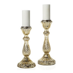 Imperial Pillar Holder - Gold - Make your special evening an exceptional event by filling a table with our stunning Imperial pillar holders, available exclusively at Z Gallerie. These highly detailed candleholders are mouth blown and hand finished by skilled artisans, using techniques employed in India's Imperial past. The brilliant hand-applied Gold finish replicates that of sought-after antique mercury glass pieces, and a shiny nickel-plated metal top holds a standard 3 inch diameter pillar candle. Available in two sizes, 7 inches diameter by 17.5 inches tall and 7 inches diameter by 15 inches tall.