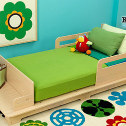 """KidKraft - Modern Toddler Bed - This toddler cot is the perfect transitional piece for your little one who is too big for the crib but too small for a bed. It accomodates your crib mattress and is built low to the ground for easy toddler access with bedrails to keep your little one secure. Its clean lines and natural wood finish give this cot a modern look for an updated look. Features: -Modern look with natural wood.-Accomodates crib mattress.-Low to ground for easy toddler access.-Distressed: No.-Powder Coated Finish: No.-Gloss Finish: No.-Solid Wood Construction: No.-Hardware Material: Metal.-Scratch Resistant: No.-Mattress Included: No.-Box Spring Required: No.-Slats Required: No.-Slat System Included: Yes.-Center Support Legs: Yes.-Number of Center Support Legs: 2.-Bed Rails: No.-Recommended Age Range: 15 Months and up.-Also Suitable for Adults: No.-Upholstered: No.-Wood Moldings: Yes.-Canopy Frame: No.-Canopy Included: No.-Lighted Headboard: No.-Light Type: No.-Adjustable Headboard Height: No.-Adjustable Shelves: No.-Underbed Storage: No.-Trundle Bed Included: No.-Hidden Storage: No.-Jewelry Compartment: No.-Attached Nightstand: No.-Media Outlet Hole: No.-Built in Outlets: No.-Weight Capacity: 50 lbs.-Finished Back: Yes.-Swatch Available: No.-Commercial Use: No.-Recycled Content: 0%.-Eco-Friendly: No.-Product Care: Wipe with a damp cloth.Specifications: -FSC Certified: No.-EPP Compliant: No.-CPSIA or CPSC Compliant: Yes.-CARB Compliant: Yes.-JPMA Certified: No.-ASTM Certified: Yes.-ISTA 3A Certified: No.-PEFC Certified: No.-General Conformity Certificate: Yes.-Green Guard Certified : No.Dimensions: -Overall Height - Top to Bottom: 18.25"""".-Overall Width - Side to Side: 31"""".-Overall Depth - Front to Back: 63.5"""".-Overall Product Weight: 59.5 lbs.Assembly: -Assembly Required: Yes.-Tools Needed: Allen wrench and phillips screwdriver.-Additional Parts Required: No.Warranty: -Product Warranty: 90 Days free replacment parts."""