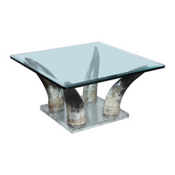 '70s Lucite and Horn Coffee Table - This horn table would be a fabulous focal point in a den or living room with a more mountainous feel. We would keep the accessories on a table like this to a minimum to accentuate the amazing horn legs.