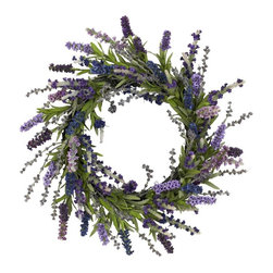 """20"""" Lavender Wreath - Wispy and wild, these charming lavenders look like they're ready to dance in the summer breeze. But they'll have to settle for delighting you and your guests from your wall, because that's where this beautiful wreath is going. This lavender wreath is perfect for those who like more of a """"wild """" look, but also prefer a little circular symmetry. Makes an ideal gift well. Height= 20 in x Width= 20 in x Depth= 5 in"""