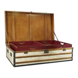"""Large Polo Club Trunk - The large polo club trunk measures 35.5 x 60 x 18"""". Once there was a time when porters took care of luggage. Appearing elegant and decorative, an army of trunks were loaded into the baggage car or the ship's hold. Royalty and upper-class in the Belle Epoque traveled with specialized trunks. Armoires, bars, libraries, and of course hat-trunks and trunks for the prize-winning poodle. Antique French trunks with famous brand names now catch exorbitant sums at auction. Except for the logo, our trunks are closely inspired by the old, classic travel trunks of yore. Canvas covered. Solid brass hardware. Steamer-varnished hardwood slats. Ideal as coffee tables, combining storage with functionality and design! Every trunk carries two sliding trays painted in signal-red. Roomy and strong, heirlooms for generations to come."""