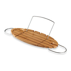 Helen Bamboo Bathtub Caddy - This tray is perfect. It has enough space for Mom's wineglass, mug and book. All she could possibly want besides this is a few moments of peace and quiet, and maybe someone to fold the laundry (or at least I imagine that's what she'd want).