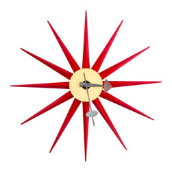 Sol Sunburst Clock in Red - Nothing's hotter than this Sol Sunburst Wall Clock. Inspired by mid-century modern design, this decorative timepiece makes a departure from the technicolor beauty of contemporary pieces and sticks to the classic, timeless beauty of bright red and the striking sunburst sculptural form.