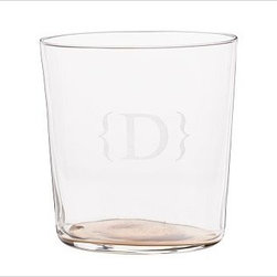 """Caroline Double Old-Fashioned Glass, Set of 6, Gold - A golden or silvery bottom brings perfect sparkle and designer style to the delicate, paper-thin walls of these handcrafted glasses made by famed master artisans in Poland. Highball: 3"""" diameter, 5"""" high; 12 fluid ounces Double Old Fashioned: 3.5"""" diameter, 3.5"""" high; 10 fluid ounces Hand blown by master craftsmen in Poland well known for the art of glass blowing and glass clarity. Enhanced with gold or silver painted bottom bases. Glasses can be used for both formal or casual table settings. Set of 6. Monogramming is available at an additional charge. Monogram will be centered on the side of each glass. Read more on our blog about the inspiration behind this product."""