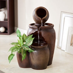 Bond Tolleson Indoor/Outdoor Fountain - This small fountain is solar powered, so you can tuck it anywhere that gets about eight hours of sunlight. I also like its natural look, as it will blend in well with the garden plants.