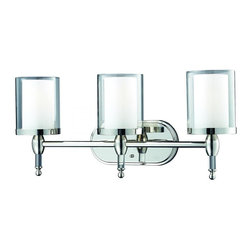 Three Light Chrome Matte Opal Glass Inside And Clear Outside Glass Vanity - This three light vanity fixture provides the ultimate clean modern look, due to its sleek chrome finish and use of combination-layered shades with clear glass on the outside and matte opal glass on the inside. To enhance this already elegant look, crystal columns compliment each shade, providing the unsurpassed elegance and sophistication.