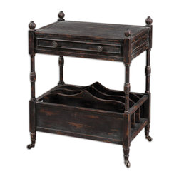 Phineas Antiqued Magazine Table - Painted Slate Black With Red Undertones And Rub-through Distressing. Table Has Four Vertical Slots For Books, French Dovetail Drawer, Carved Finials, And Antiqued Castors. Bulbs Included: No