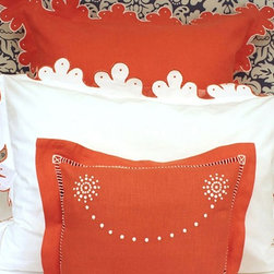 Calais Bedding Collection - This is one of my favorite combinations: bright orange and crisp white — and that most fabulous scalloped edge with orange embroidery. OK, so this comes at a high price point, but I give it a big thumbs up for originality and elegance. I also love the way it is juxtaposed against the black and white fabric on the headboard — that just makes the look complete.
