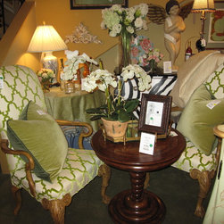 Photos from our furniture gallery at European Home - A pair of accent chairs upholstered in a green and white cut velvet are from our vendor Century furniture company.  Accent table from Marge Carson