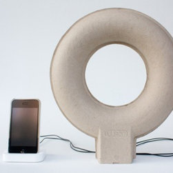 Pulpop, Paper Pulp Speakers by Balance Studio - The Pulpop MP3 speakers are made from recycled paper pulp and they use vibration speaker technology to intensify the sound through the surface on which they stand, as well as through the hollow space inside the doughnut. The loop shape dispenses the high quality sound nice and smoothly.
