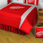 Sports Coverage - Detroit Red Wings Bedding - NHL Sidelines Comforter and Sheet Set Combo - Queen - This is a great NHL Detroit Red Wings Bedding Comforter and Sheet set combination! Buy this Microfiber Sheet set with the Comforter and save off our already discounted prices. Show your team spirit with this great looking officially licensed Comforter which comes in new design with sidelines. This comforter is made from 100% Polyester Jersey Mesh - just like what the players wear. The fill is 100% Polyester batting for warmth and comfort. Authentic team colors and logo screen printed in the center.   Microfiber Sheet Hem sheet sets have an ultrafine peach weave that is softer and more comfortable than cotton.  Its brushed silk-like embrace provides good insulation and warmth, yet is breathable.  The 100% polyester microfiber is wrinkle-resistant, washes beautifully, and dries quickly with never any shrinkage. The pillowcase has a white on white print beneath the officially licensed team name and logo printed in vibrant team colors, complimenting the NEW printed hems. The Teams are scoring high points with team-color logos printed on both sides of the entire width of the extra deep 4 1/2 hem of the flat sheet.  Includes:  -  Flat Sheet - Twin 66 x 96, Full 81 x 96, Queen 90 x 102.,    - Fitted Sheet - Twin 39 x 75, Full 54 x 75, Queen 60 X 80,    -  Pillow case Standard - 21 x 30,    - Comforter - Twin 66 x 86, Full/Queen 86 x 86,
