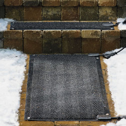 """Frontgate - Outdoor Heated Stair Mats Starter Kit - Exclusive herringbone weave design. Outdoor Heated Stair Starter Kit includes 2 mats and power cord. Power up to 8 stair mats or 4 walkway mats on one outlet. Doormat operates from separate outlet. View our buying guide for more information. Our Heated Outdoor Entry and Stair Mats keep your entryways clear and safe during the snow season without harsh chemicals that can pit or stain surfaces. Plugged into a standard outlet, the durable olefin-fiber mats melt 2"""" of snow and ice per hour, and can be left outside all season long.  .  .  .  . . New 40"""" x 60"""" mat offers more coverage . Single stair mats do not include power cords and must be used with a Starter Kit or connected to the runner. Optional 20-in. and 25-ft. watertight cable extenders can be used with the runner or stair mats . 6 ft. power cords; 120V . Stair Mats Starter Kit includes two 10"""" x 48"""" stair mats and power cord. View instructions manual. Note: Not for use on composite decking."""