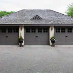 Classic Style - This carriage house called for a traditional looking carriage style garage door.  We were able to give it great style and the decorative hardware really helped the authentic look.