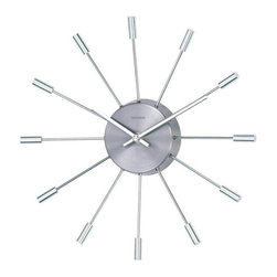 George Nelson - Metal Pill Starburst Clock - A starburst pattern with capped ends highlights this retro look wall clock, a reproduction of a classic George Nelson design. Finished in silver tone, the battery operated clock has a round face in polished metal finish and will be stunning in a great room, dining room or entry. Uses 1 AA battery (not included). Designed by George Nelson . Retro design. High-grade quartz movement. Keeps accurate time. 12 pieces shining aluminum tube as hour markers. Polished metal center. 2.25 in. D x 13 in. W x 13 in. H (1.10 lbs.)This retro clock is a George Nelson Reproduction, the polished metal center is surrounded by 12 shining aluminum tube with bold tops as numbers. The minute hands complete the retro style. Dress up your modern room by this sunburst wall clock. High quality quartz movement powered by one 'AA' battery not included