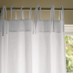 Serena & Lily - Swiss Dot Window Panel  Sheer White - The textured chenille blankets of the 60s inspired this sweet design. Miniature dots give it a touch of vintage, light cotton brings a breezy vibe, and narrow ties top it off with charm. We love it for the nursery.