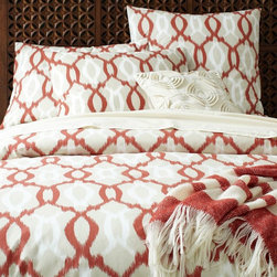 Organic Ikat Links Duvet Cover + Shams - I'm not normally a fan of red in home decor, but I love it on this duvet. The ikat trellis pattern makes it more modern.