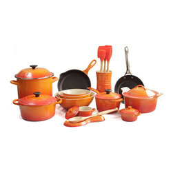 Le Creuset - Le Creuset 25 Piece Deluxe Cookware Set, Flame - Prepare a gourmet meal for the whole family with this Le Creuset 25 piece cookware set that blends colorful design with impeccable functionality and versatility. This set features the iconic enameled cast iron 3.5 quart round Dutch oven, the covered 1.75 quart saucepan, the 9 inch skillet, a non-stick stainless steel 8 inch Frypan, and an enamel on steel covered 10 quart stockpot. For your baking pleasure, this set features a stoneware covered 3 quart round casserole dish, small 0.6 quart, medium 1.7 quart, and large 3.1 quart multibowls, and two covered 8 ounce mini cocottes. Also includes a stoneware spoon rest and crock filled with the silicone and Samak wood jar scraper, small spatula, medium spatula, spatula spoon, basting brush, and a beechwood solid spoon as well.Perfect for locking in flavor and keeping foods moist and tender, each piece of enameled cast iron is made with an exterior that resists chipping and cracking. The lightest weight cast iron per quart, the signature 3.5 quart round Dutch oven is designed to enhance the cooking process by evenly distributing heat and locking in the optimal amount of moisture.