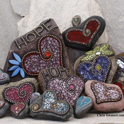 Garden Stones and Paperweights - I love making mosaic garden stones and paperweights. Searching for the rocks and stones to do each mosaic is a lot of fun. See more in these sections: http://www.etsy.com/shop/ChrisEmmertMosaic?section_id=7478014 (larger stones) http://www.etsy.com/shop/ChrisEmmertMosaic?section_id=11624170 (smaller stones)