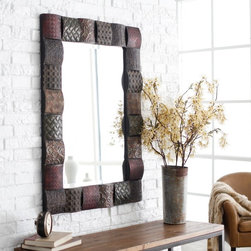 Uttermost - Ganya Embossed Sheet Metal Frame Vanity Mirror - 30W x 40H in. Multicolor - 1336 - Shop for Mirrors from Hayneedle.com! For a uniquely modern and artistic piece you'll love the Ganya Embossed Sheet Metal Frame Mirror anywhere in your home. This decorative mirror features hand-embossed sheet metal over convex wooden squares. The frame is finished in a combination of rust brown sage green aged white antiqued gold and mahogany. This mirror features a generous 1.25-inch bevel. About UttermostThis unique mirror is created by Uttermost. The mission of the Uttermost Company is simple: to make great home accessories at reasonable prices. This has been their objective since founding their family-owned business over 30 years ago. Uttermost manufactures mirrors art metal wall art lamps accessories clocks and lighting fixtures in its Rocky Mount Virginia factories. They provide quality furnishings throughout the world from their state-of-the-art distribution center located on the West Coast of the United States.