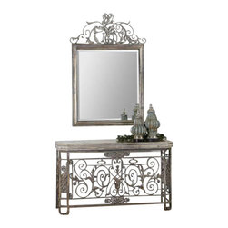 Uttermost Kissara Metal Console Table - An open, forged metal base with curled flourishes and leaf details in warm, tarnished silver, and tabletop highlighted in a silvery mercury patina. An open, forged metal base with curled flourishes and leaf details in warm, tarnished silver with the tabletop highlighted in a silvery mercury patina. Matching mirror is item #12865.