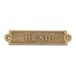 Handcrafted Nautical Decor - Antique Brass Head Sign - Ideal   for posting on a boat, in boathouse, or any room in the home or office,   this solid brass Head sign clearly identifies the room it graces. Handcrafted  from solid brass with an antique brass finish, this sign has a classy nautical appeal, with bold and clear lettering  on an antique brass face. ------    Elegant solid brass design--    --    Stylish antique brass finish--     Handcrafted with precise detail--    --     Textured solid brass background--    --    Sign requires two screws for easy mounting (not included)--    --
