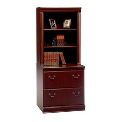 Bush Birmingham Lateral File with Hutch - Harvest Cherry - Make a powerful decorating statement with the Bush Birmingham Lateral File with Hutch - Harvest Cherry. A grooved pediment adds an engaging shape to the top of this cabinet. The drawers each have charcoal gray handles in a traditional shape, and the wood has a Cherry finish. Put letter or legal sized files in this cabinet as the drawers effortlessly glide on full extension ball bearing slides. This cabinet adds a dash of elegance in a formal decor.You will have the opportunity to purchase matching furniture accessories once you have placed the cabinet in your shopping cart.About Bush FurnitureBush Furniture is the eighth largest furniture company in the United States. Bush manufactures high-quality products, which are designed to be easily assembled and provide great value for the price. Bush furniture is made from a combination of particleboard, fiberboard, and solid wood components. The use of real wood components will be noted in the product description, if applicable.Bush Industries has over 4,000,000 total square feet of manufacturing, warehousing, and distribution space. This allows for a very wide selection of high-quality furniture with the ability to ship quickly. All standard residential Bush products carry a generous 6-year warranty. All Bush business furniture, including the A series, C series, and Quantum series, is backed by a 10-year warranty from Bush, one of the best in the industry.Please note this product does not ship to Pennsylvania.