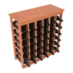 36 Bottle Kitchen Wine Rack in Redwood with Satin Finish - A small wine rack with big storage. This wine rack kit is the best choice for converting tiny spaces into big wine storage. The solid wood top excels as a table for wine accessories, small plants, and wine collectables. Store 3 cases of wine properly in a space smaller than most entry tables!
