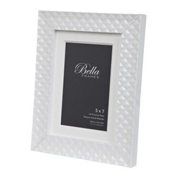 """Origin Crafts - White quilted patent leather picture frame - White Quilted Patent Leather Picture Frame The moulding is imported from Italy. Base wood is Ayous. Gold and Silver and metal leaf. Black and White are painted and lacquered. All Bella Moulding Frames include 100% Archival Materials and UV Protective Glass. 5x7 & 8x10 Frames come with optional mat for size down. 4x6 Frame does not come with mat. Dimensions (in):Holds (4""""x6"""", 5""""x7"""" (Matted 4x6), 8""""x10"""" (Matted 5x7) photos. By Bella Moulding - Bella Moulding is a distributor of unique wood mouldings produced by the finest manufacturers in Europe, the US and Asia. Their mouldings have been specially selected by framers, for framers, looking to set themselves apart from their competition. The line ranges from beautifully stained hardwoods, intricate patterned marquetry, all wood veneers and elegant water-gilded mouldings. Usually ships within five Business Days"""