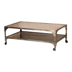 Four Hands - Element Coffee Table - Let the good times roll. This metal coffee table has an industrial appeal sure to rock your room in the most riveting of ways. And the second tier is ready to hold your remotes, coasters and vintage magazines.