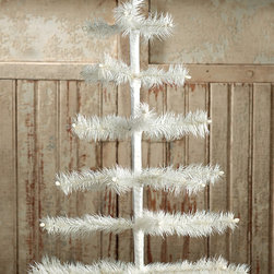 "Ivory Feather Tree in Urn Base 26"" - A stunning, hand-dyed, hand-wrapped goose feather tree inspired by the German feather trees created as early as 1845. This tree is both whimsical and glamorous and will look excellent on a holiday table adorned with your choice of ornaments."