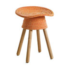Umbra Shift - Coiled Stool by Harry Allen, Red - The Coiled Stool was inspired by the traditional basket-making techniques of the Philippines. Hand-woven threads cover a rattan core to create a surprisingly comfortable tractor seat. The Coiled Stool fits easily into casual and formal environments. Umbra Shift is an extension of Umbra that focuses on contemporary influences in the design community. For more than 30 years, Umbra has broken the mold by creating entirely new categories that apply thoughtful design to everyday items. Umbra Shift revisits these roots with a roster of established, emerging, and in-house designers who share Umbra's passion to re-think things, designing personal objects they themselves would want to give or use at home. The result is a collection that expresses diverse points of view, yet sits together with a shared belief in ideas that are functional, familiar and forward thinking.