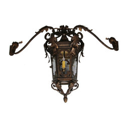 Custom Exterior Iron Lights - Classic and elegant design in this exterior hand forged iron lantern with 3 lights. Clear seeded glass, powder coat base and an additional hand applied color finish for that Old World look are elements that are always included in our exterior pieces.