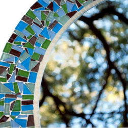 Mosaic Mirrors from Green Street Mosaics - This round decorative wall mirrored was created with Sky (Blue), Barely Blue (Lighter Blue), Grass (Green), Celadon (Lighter Green), Walnut (Brown) and Metallic Mocha (Metallic Brown) glass tiles. The inside border is made up of mini eco tiles in Ivory. The piece was grouted in off white and sealed. Hanging hardware was attached.