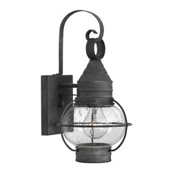 "Hinkley - Hinkley Cape Cod 14"" High Aged Zinc Outdoor Wall Light - Perfect for adding accent lighting to a patio or doorway, this small outdoor wall light is a classic style enhanced with a lovely aged zinc finish. Featuring a solid aluminum construction for durability that will stand up to the elements, this outdoor wall light is a striking traditional accent full of charm and old world appeal. Thin metal caging encloses the clear seedy glass globe and is capped at the top and bottom with metal accenting, all finished in rustic aged zinc. The light fixture is securely mounted to the flush mount base plate, but also features a curved metal hanger that lends classic charisma to this fixture from the Cape Cod Collection by Hinkley Lighting."