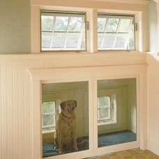 Crate/doggie door to get outside from house. Large door that locks from inside.
