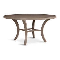 Carter Round Dining Table - Taupe - Relaxed curves and unfussy outlines make the Carter Round Dining Table an elegant place to enjoy a meal, whether it sits in a townhouse or a beach house. This versatile table, finished in a sophisticated neutral taupe, is constructed from solid hardwood with its legs and stretchers formed to emphasize the grace of a table sized for long family evenings and culinary enjoyment.