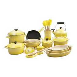 Le Creuset - Le Creuset  26 Piece Ultimate Kitchen Cook and Bakeware Set, Soleil Yellow - Prepare a gourmet meal for the whole family with this Le Creuset 26 piece ultimate cook and bakeware set that blends colorful design with impeccable functionality and versatility. This set features the iconic enameled cast iron 3.5 quart round Dutch oven, the covered 1.75 quart saucepan, the 9 inch skillet, an enamel on steel covered 10 quart stockpot, and an enamel on steel 1.7 quart whistling kettle. For your baking pleasure, this set features a stoneware covered 3 quart round casserole dish, 3.1 quart, 1.7 quart, and 1 quart Au Gratin dishes, a small 0.6 quart, medium 1.7 quart, and large 3.1 quart multibowls, and two covered 8 ounce mini cocottes. Also includes a stoneware spoon rest and crock filled with the silicone and Samak wood jar scraper, small spatula, medium spatula, spatula spoon, basting brush, and a beechwood solid spoon as well.Perfect for locking in flavor and keeping foods moist and tender, each piece of enameled cast iron is made with an exterior that resists chipping and cracking. The lightest weight cast iron per quart, the signature 3.5 quart round Dutch oven is designed to enhance the cooking process by evenly distributing heat and locking in the optimal amount of moisture.