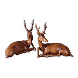 Uttermost - Buck Wood Tone Statues, Set of 2 - Be a dear and invite some of your woodland friends home. The long limbs, majestic antlers and curved necks of these elegant deer are artistically rendered in soft, wood-tone resin. Capture the spirit of nature's most graceful woodland creature with these deer statues on your fireplace mantel or dresser.