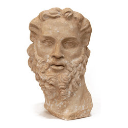 Artist Bust - A prestigious artifact for the luxury home whether its surroundings are traditionally august or eclectic and bold, this sweeping Artist Bust has the look of an ancient marble sculpture with sensitively modeled features, Romanesque curls, and a fine thoughtful expression. Caught by the sculptor in the moment of turning, the mature man who is depicted in this bust - perhaps a poet or a senator - appears constantly about to speak his innermost thoughts.