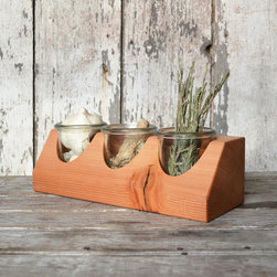 Tres Display Caddy - This versatile tabletop display caddy is fashioned of reclaimed wood and finished with tung oil, and contains three removable tall glass jars for easy cleaning. Feature in a kitchen setting to hold cutlery, spices, and garlic cloves, in your art studio or office for brushes and pencils, or even in the bathroom for toiletries—there are infinite possibilities with this nature-inspired, multitalented piece.